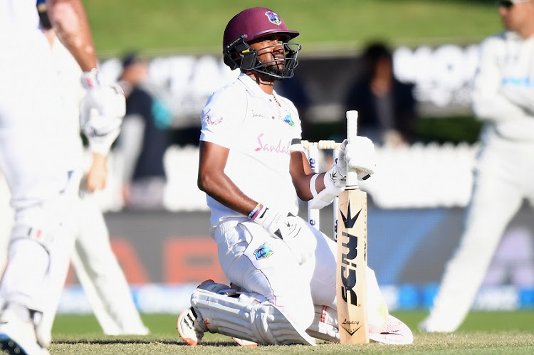 Kraigg Brathwaite of the West Indies reacts after being hit by a ball during day two of the First Test match in the series between New Zealand and the West Indies at Seddon Park on December 04, 2020 in Hamilton, New Zealand.