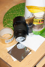 Photo: ingredients:  1x 70-300mm lens, 1xblack acrylic paint, 1x double-sided tape, 2x cardboard cup, 1x sheet of Baader ND3.8