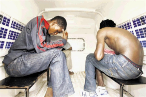 OFF TO JAIL: Three of the alleged armed robbers under arrest after they held up the Scooters Pizza shop in southern Johannesburg yesterday morning. PHOTO: ANTONIO MUCHAVE. 20/09/2009. © Sowetan.