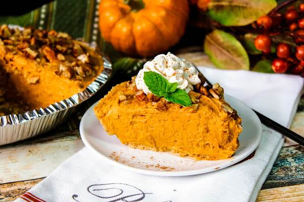 Slice Of Butterscotch Pumpkin Pudding Cheesecake On A Plate.