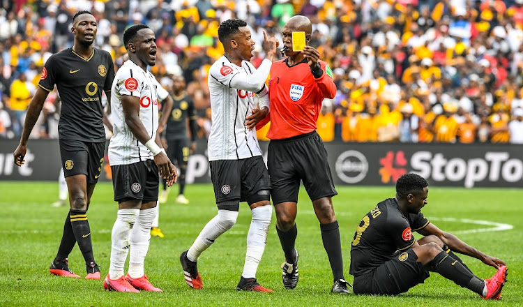 Happy Jele (captain)of Orlando Pirates challenges the referee on the latter's decision, which went against Gabadinho Mhango of Orlando Pirates in his contact with Kgotso Moleko of Kaizer Chiefs during the Absa Premiership match between Orlando Pirates and Kaizer Chiefs at FNB Stadium on February 29, 2020 in Johannesburg, South Africa.