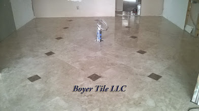 Photo: Finished marble floor installation, in this room. Very near perfect and very impressive piece of work. Note that the rest of the room has much work not yet done by other craftsmen. Hopefully, they will take care not to harm my work. Sadly, it happens.