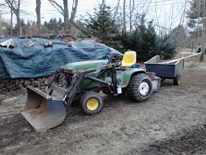 Photo: One of my husband's tractors.  Used in 30 degree weather for moving 8 tons of gravel today.  Glad to have something to help keep it running well!