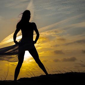 Sunset at the beach by Ton Hoelaars - People Portraits of Women ( wind, sunset, woman, maasvlakte, beach )