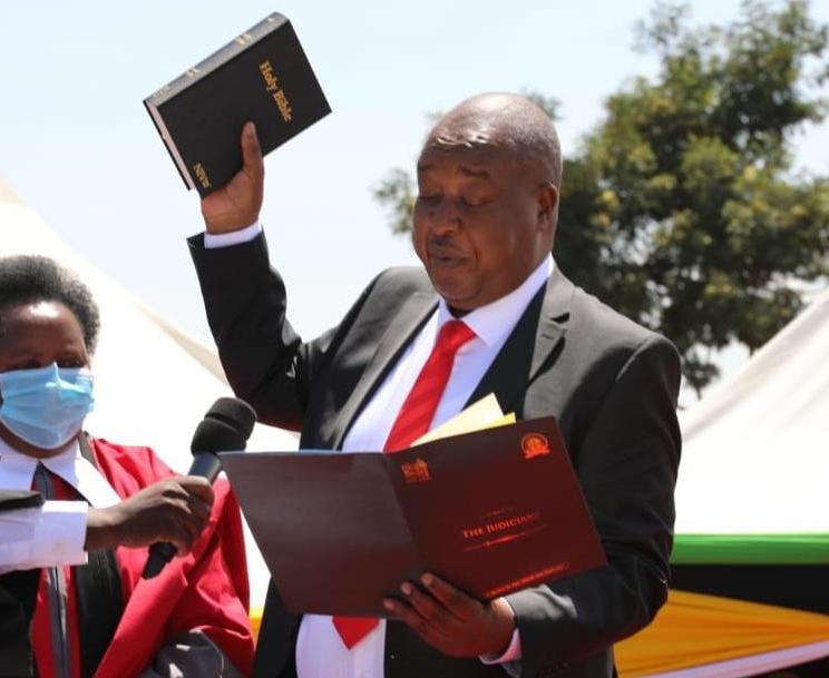 Nyamira Governor Amos Nyaribo taking oath of office at the Nyamira primary school grounds in Nyamira town on Tuesday./ALVIN RATEMO