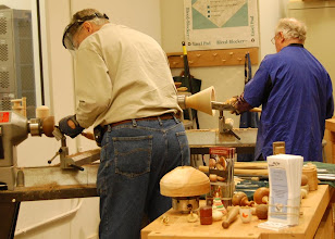 Photo: Bert Bleckwenn and Phil Brown demoing in the woodworking room at Visarts.