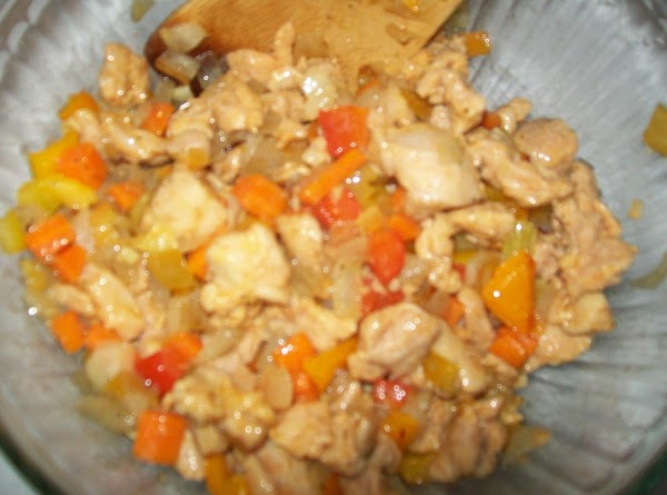 Add the cooked chicken to the vegetables and mix thoroughly.