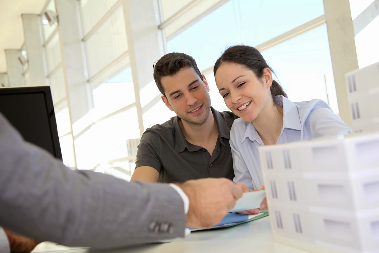 Two renters discussing their new property with an agent