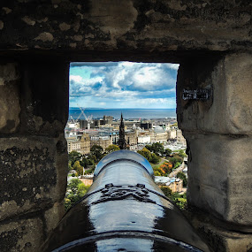 Edinburgh Castle Cannon by Justin Hyder - City,  Street & Park  Historic Districts ( capital, castle, city, cannon, historical, tourism, protection, monument, holiday, building, scotland, view, design, dark, peering, cityscape, landmark, cathedral, architecture, tower, sky, st, giles, old, overlook, black, edinburgh, medieval, war, history, stone, urban, background, vintage, window, travel, wall )