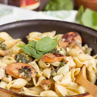 Creamy Spinach Artichoke Sausage and Chicken Pasta.