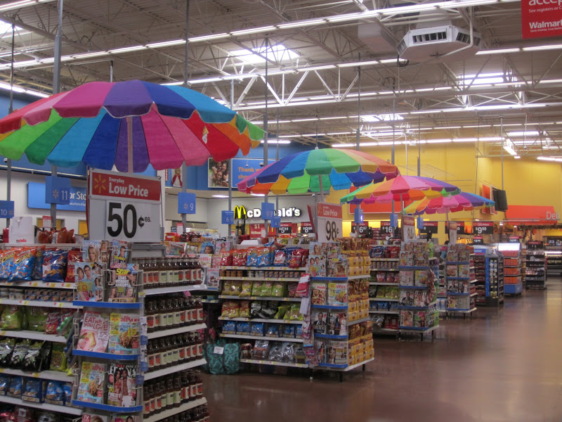 Photo: I love Walmart at the beach. Registers with umbrellas!
