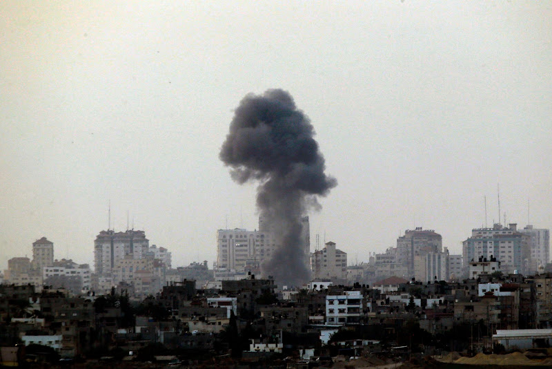 Photo: Black smoke rises after an Israeli airstrike in the central Gaza Strip.