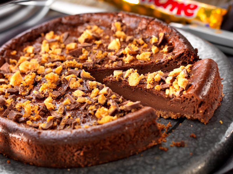 Photo: With Christmas fast approaching we thought we'd remind you of this classic #CadburyKitchen  creation... who wouldn't be excited to tuck into a BAKED CHOCOLATE AND CRUNCHIE CHEESECAKE sometime over the festive period? ;)  Ingredients: 50g unsalted butter 100g digestive biscuits, crushed finely 1 Cadbury Crunchie, chopped finely 320g Philadelphia Cadbury 75g caster sugar 1 Tbsp cocoa 1 Tbsp plain flour 3 medium eggs 150ml soured cream  Method: 1. Preheat the oven to Gas 2, 150 C and grease a 20 cm loose based tin. 2. Melt the butter and stir in the biscuits and half of the crushed Crunchie.  Mix well and then press into the base of the tin.  Set aside. 3. In a bowl, beat the Philadelphia and sugar together then add the  sieved cocoa and flour. Mix well then beat in the eggs and soured cream until smooth. 4. Pour over the biscuit base and bake for 45 minutes, turn off the oven and allow to cool with the door slightly ajar for 1 hour.  Remove and chill for a couple of hours or overnight.  Before serving, remove from the tin and place onto a serving plate and scatter the remaining Crunchie over the top.  Posted by +Jerry Daykin.