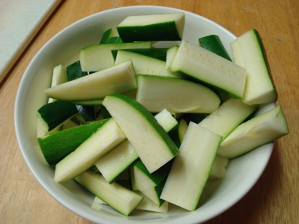 Slice zucchini in half lengthwise. Cut each half into 4 slices (lengthwise). Cut each...