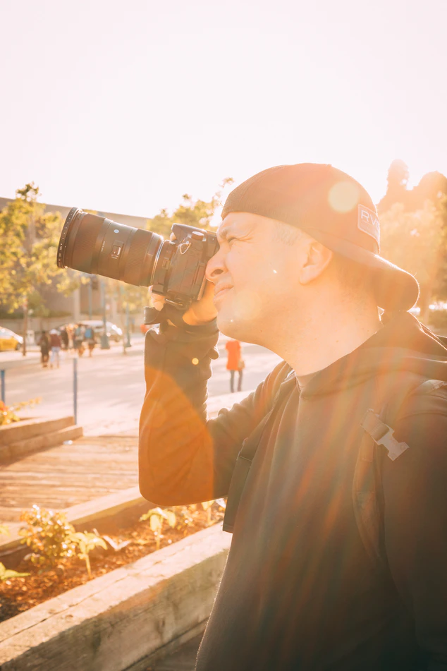 man taking photo in golden light