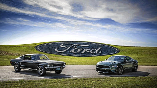 The new 2019 Bullitt (right) pays homage to the 1968 Mustang (left), with the same Dark Highland Green colour.