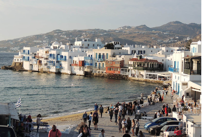 Cruise ship passengers begin the explore the waterfront of Mykonos.