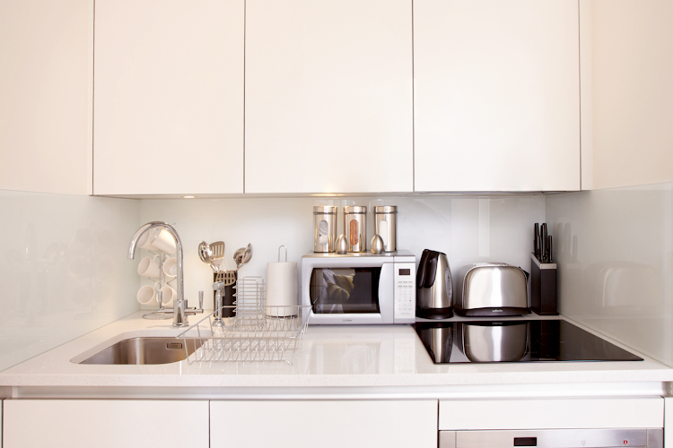 Fully equipped kitchen at London City Apartments
