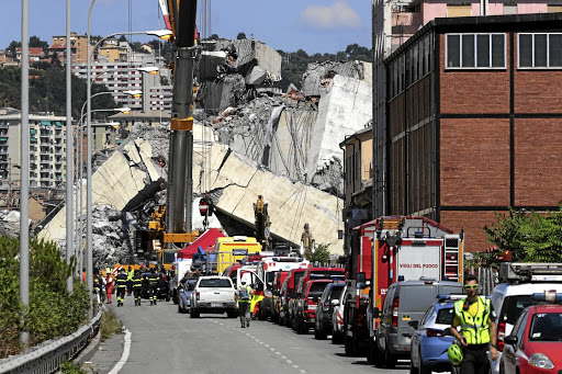 Firefighters and rescue workers attend the site of the collapsed Morandi Bridge in the port city of Genoa, Italy, on August 15 2018. Picture: REUTERS/STEFANO RELLANDINI