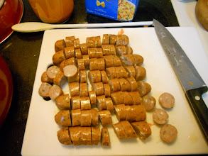 Photo: chopped up both packages of #GourmetCreations sausages.