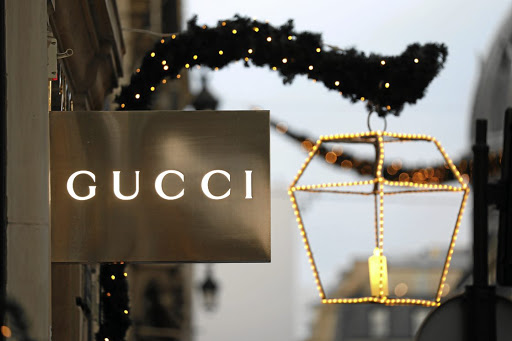 e4ab95c6a Iconic  A Gucci sign is seen outside a shop in Paris. The fashion powerhouse
