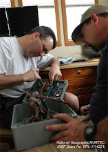 Photo: ROV technicians investigate problems with control box associated high-power shipboard RADAR (Photo credit: P. Auster/NSF Grant N. DRL-1114251)