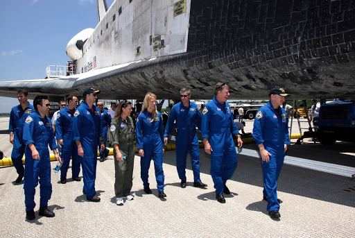 The mission crew members finish their traditional walk around space shuttle Discovery to end a mission to the International Space Station.