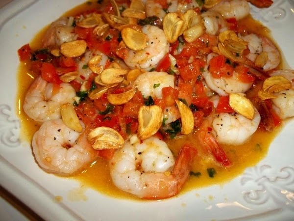 Pour sauce over the shrimp and sprinkle with garlic slivers.  Serve with a salad and...