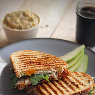Easy Turkey Paninis with Bacon, Arugula, & Caramelized Onions.