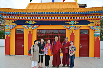 Photo: Jetsun Ma (third from left) and four of Yuan Yuan members stood in front of the Medicine Buddha Shrine with His Holiness Menri Trizin Rinpoche and his attending monk.