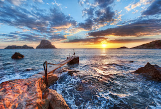 Photo: The Last Sunset - Ibiza, Spain  I saw this dock early in the day, and I was secretly hoping that it might just point towards the sun as it passed the horizon. So I had this shot planned along with about 10 others. Some worked out and some didn't. This is one of the ones that worked out.  from the blog www.stuckincustoms.com