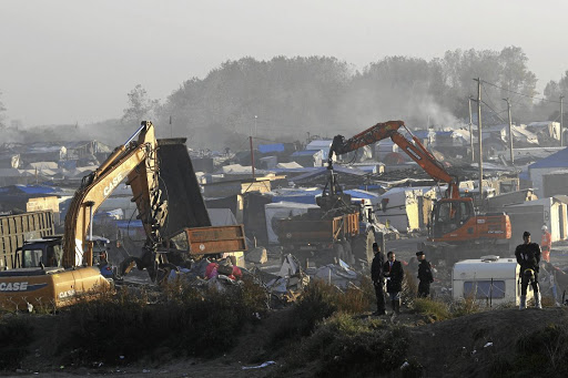 Bulldozers remove debris as workers tear down makeshift shelters during the dismantlement of the camp known as the Jungle in Calais, France, on October 27 2016. Picture: Reuters