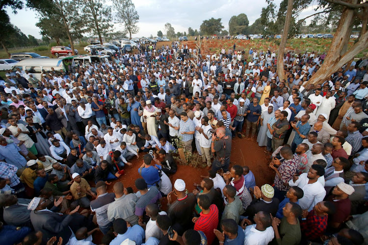 People pray during the funeral of Feisal Ahmed Rashid and Abdallah Mohamed Dahir who were killed in an attack on an upscale hotel compound, at the Langata Muslim cemetery, in Nairobi, Kenya, on January 16 2019. Picture: REUTERS/THOMAS MUKOYA