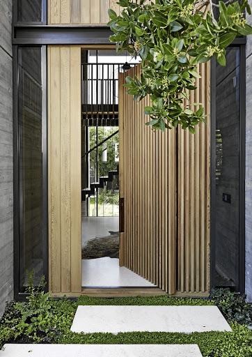 The front door sets the tone for the interiors, combining beautifully cast concrete, imprinted with a timber grain.
