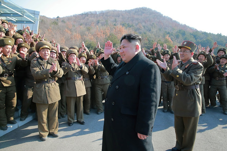 North Korean leader Kim Jong-un is greeted by officers after supervising a ballistic rocket launch drill in this undated picture released by North Korea's Korean Central News Agency in Pyongyang on Tuesday. Picture: REUTERS