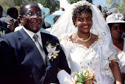 Then president Robert Mugabe and his wife Grace leave the Kutama Catholic Church in Zimbabwe August 17 1996 after exchanging their wedding vows.
