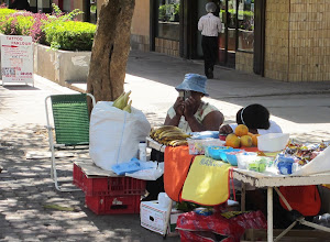 Photo: The most common selection of merchandise offered in central Gaborone: some candies, some fruits and some talk time for the mobile phones