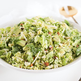 Healthy Shaved Brussel Sprout Salad with Citrus Shallot Vinaigrette.