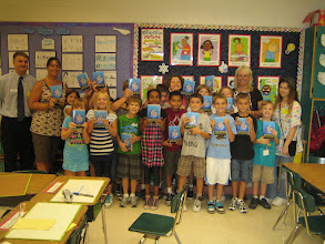 Photo: Rotarian Eric Sanders and the third grade class at DeBary Elementary School.  -  With Eric is the students' teacher Jennifer Stoddard, Principal Teresa Marcks, and Lorenza Scudder. The students were overjoyed having just received their special dictionaries. The dictionary is packed full of interesting information. Can you remember way back when you were in the third grade?
