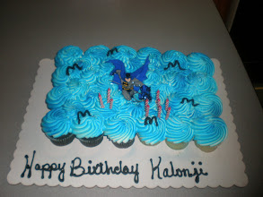 Photo: gotta love the batman cupcake cake!