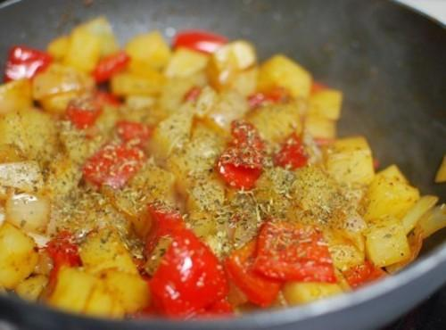 Add the potato pieces and the seasonings. Cook until the potatoes are golden and...