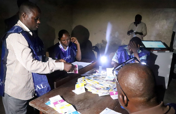 FILE: Agents of Congo's National Independent Electoral Commission (CENI) count casted ballot papers after election at a polling station in Kinshasa, Democratic Republic of Congo, December 30, 2018.