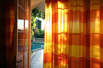 Photo: The summer kitchen has colourful curtains.