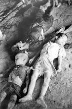 Photo: Hai trẻ nhỏ và một phụ nữ trong số 9 thường dân Việt Nam bị sát hại bởi khủng bố Việt Cộng tại ấp Cẩm Vân, khoảng 15 km về phía nam Đà Nẵng. Các thi thể được phát hiện trong một túp lều làng 05 Tháng 8. Hai đứa trẻ khác và một người lớn đã được tìm thấy vẫn còn sống, một em đã chết sau đó tại một bệnh viện Đà Nẵng. Tất cả đã bị Việt cộng khủng bố đánh đập và sau đó bị bắn chết . Người dân kể lại rằng, hàng loạt bắn giết xảy ra sau khi cha mẹ và người thân của các em đã từ chối hợp tác với Việt cộng. http://www.vietnam.ttu.edu/virtualarchive/items.php?item=va004321   These two small boys and a woman were among nine Vietnamese civilians murdered by Viet Cong terrorists in the hamlet of Cam Van, about 15 kilometers south of Da Nang in South Vietnam. The bodies were discovered in a village hut August 5 by a U.S. Marine patrol. Two other children and one adult were found still alive; one child died later in a Da Nang hospital. All had been beaten and then machine-gunned by the terrorists. Villagers said the mass slaughter occurred after the children's parents and relatives refused to cooperate with the communists. http://www.vietnam.ttu.edu/virtualarchive/items.php?item=va004321