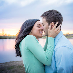 Sweet Kisses by Amber Welch - People Couples ( kiss, sunset, embrace, couple, lake, engagement )