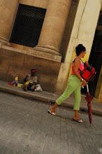 Photo: Umbrella walker of La Habana vieja http://www.isaacholeman.org/2007/libre-in-cuba-my-arrival-in-havana