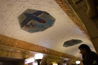 Photo: View of the ceiling at the Novokuznetskaya station. The mosaic of a Soviet fighter pilot standing on his plane. https://en.wikipedia.org/wiki/Novokuznetskaya