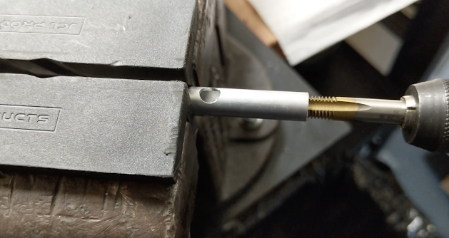 Cut a hole into the side of the tube for powder to enter, then tap the end.