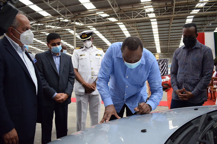 Simba Corp Group executive chair Adil Popat, CEO Dinesh Kotecha, President Uhuru and Governor Hassan Joho at the AVA plant in Miritini on Thursday.