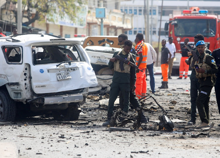 Somali security officers assess the scene of an explosion in Mogadishu, Somalia, February 13 2021. Picture: REUTERS/FEISAL OMAR